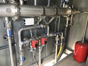 Biogas cooling system inside container unit