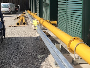 Steel pipework painted yellow installed at BUSE Gas Site